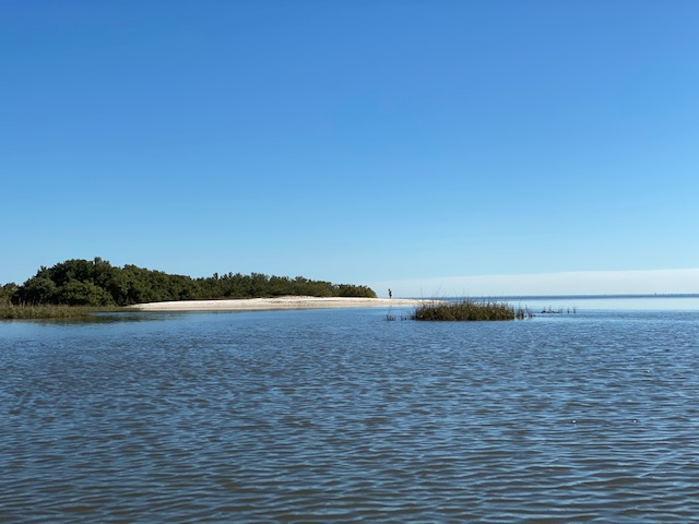 Kayaking to island beach in Cedar Key